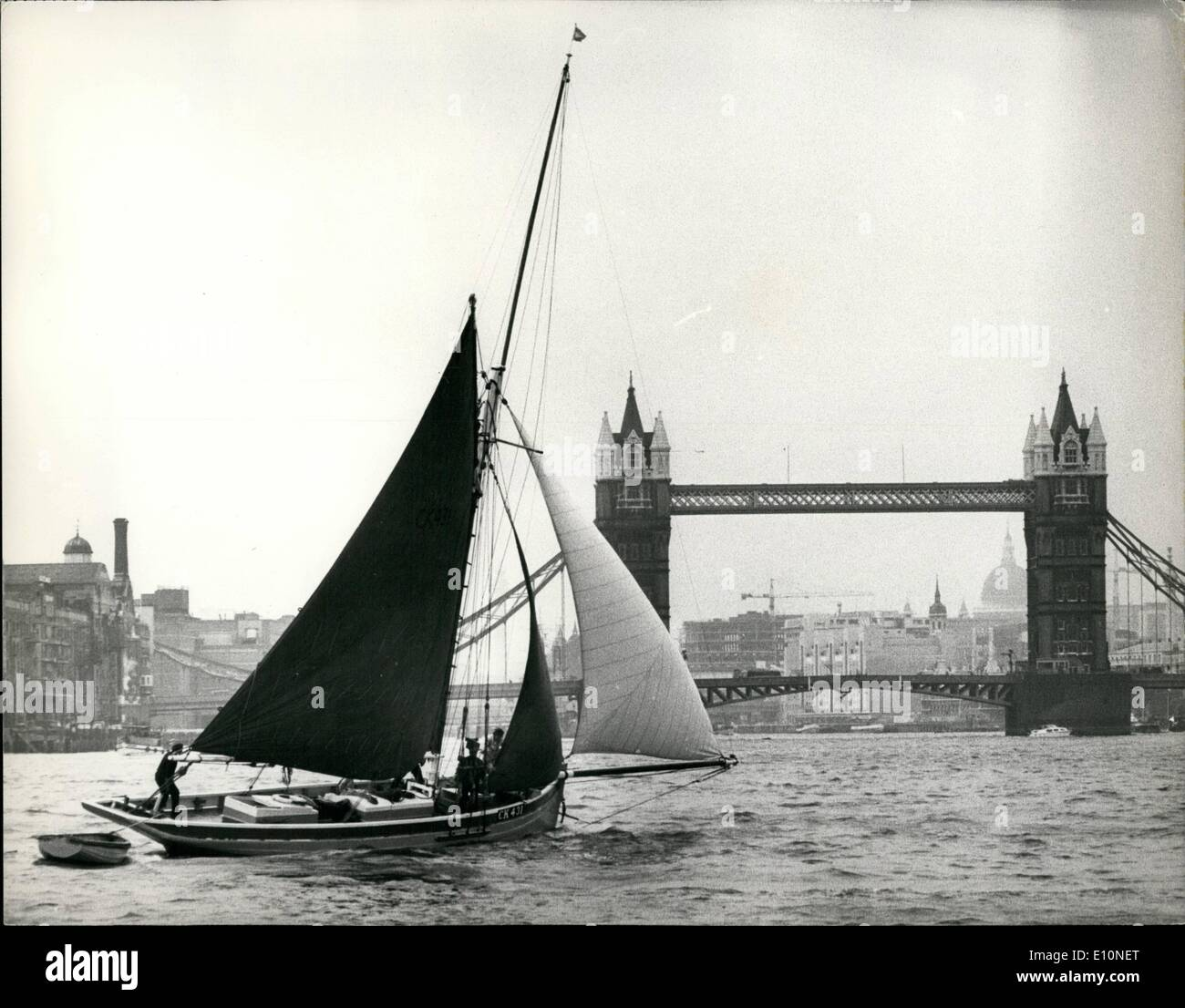 Aug. 08, 1973 - The Thames Oyster smack race.: Seventeen vintage boats, not one of them built in this century, today competed in the Thames Oyster Smack Race, starting from Gravesend and finishing at Cherry Garden Pier, about a mile below Tower Bridge. The race, which is organized by the Fishmonger's Company on behalf of the Shellfish Association, was won by the ''A.D.C.''. Photo shows the winning smack ''A.D.C.'' crossing the finishing line below Tower Bridge (background) - Stock Image