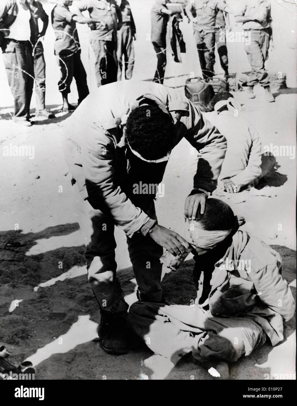 an Egyptian prisoner giving water to a comrade during 1973 Yom Kippur War in Cairo - Stock Image