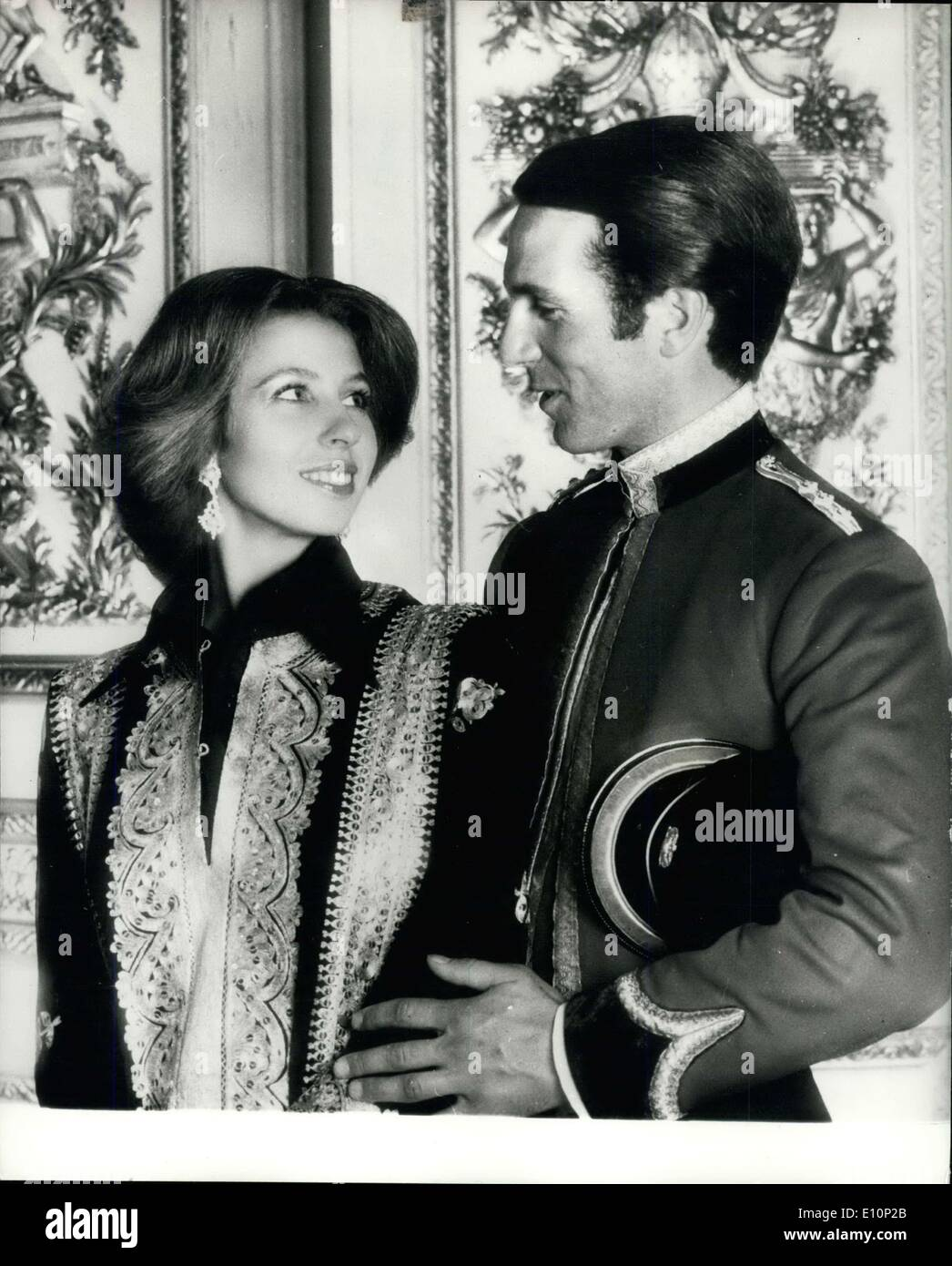 Nov. 06, 1973 - HRH Princess Anne And Captain Mark Philips; The marriage of HRH Princess Anne and Captain Philips of the Queen's Dragoon Guards will take place on November 14th - 1973 at Westminster Abbey. Princess Anne is wearing a black silk shirt and trousers with a black and gold caftan, pearl and diamond earrings set in gold. Captain Philips is in the Mess Kit of his regiment. The photograph was taken in the Crimson Drawing Room at Windsor Castle. - Stock Image