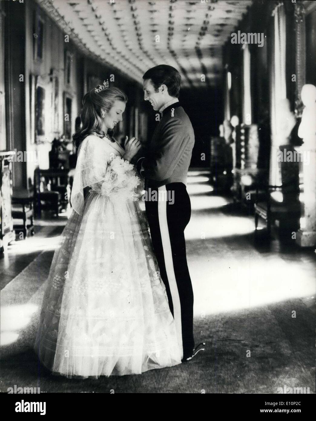 Nov. 06, 1973 - HRH Princess Anne And Captain Mark Philips: The marriage of HRH Princess Anne and Captain Philips of the Queen's Dragoon Guards will take place on November 14th, 1973 at Westminster Abbey. The Princess and Captain Philips are seen in the Long Gallery at Windsor Castle. With her full length white dress (by Zandra Rhodes) Princess Anne is wearing a diamond tiara, Diamond earrings and a diamond necklace, Captain Philips is wearing the Mess Kit of his regiment. - Stock Image