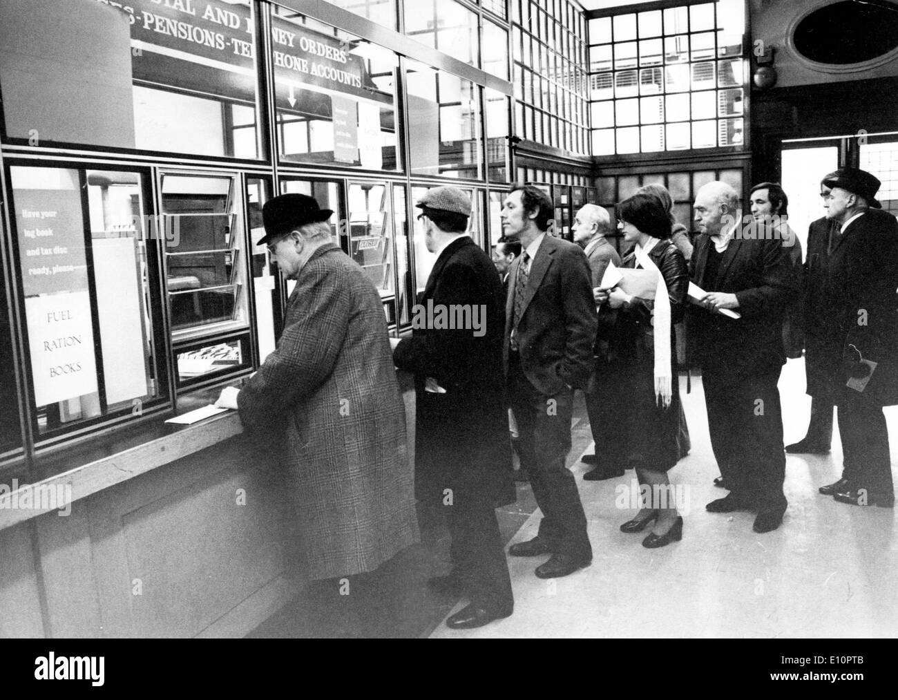 1973 oil crisis - People standing in a line to acquire oil ration cards - Stock Image