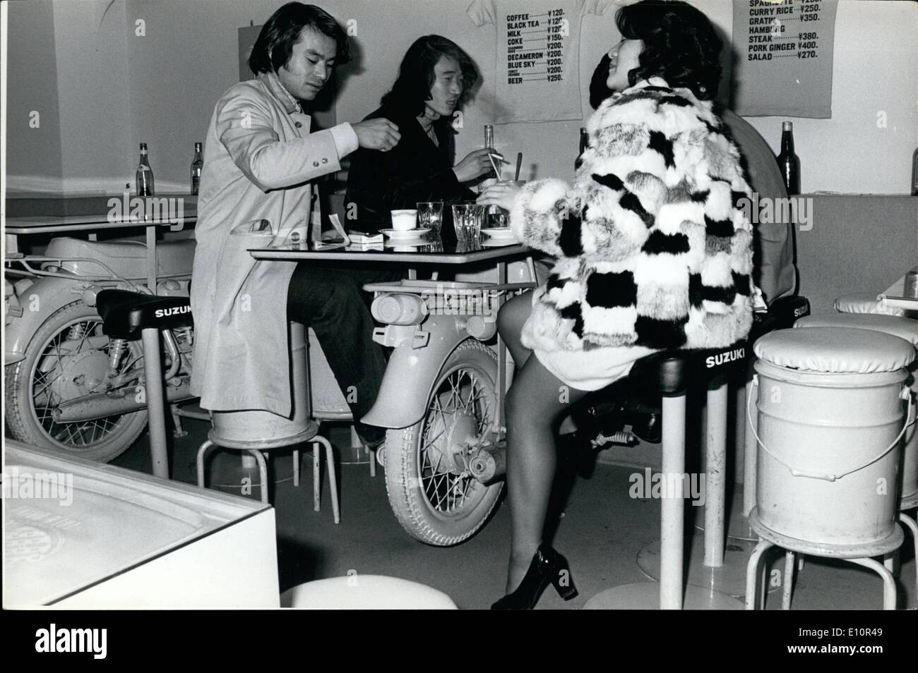 Dec. 12, 1973 - Tokyo snack bar uses junk as furniture; As an attraction, a snack bar in the populous district of Shinjukum Tokyo has utilized junk as a decor, Tables are supported by gaily colored motorcycles, and some of the seats are motorcycle, saddles or garbage cans with a padded top. - Stock Image