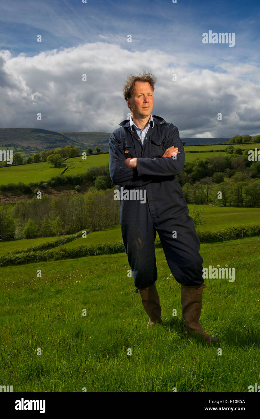 Farmer John Lewis-Stempel has written a book about meadows and is seen in a Herefordshire field surrounded by buttercups.a UK - Stock Image