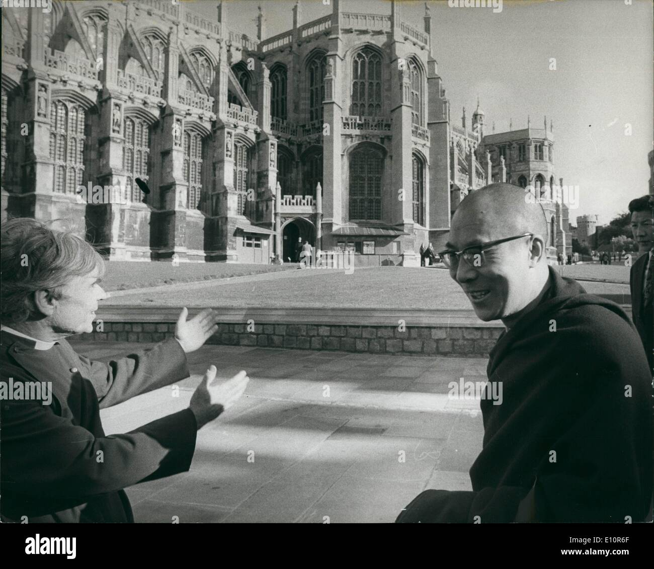 Oct. 10, 1973 - Dalai Lama At Windsor: The Dalai Lama, ''God-King'' of Tibet's Buddhists, yesterday attended Holy Communion in St. George's Chapel, Windsor. He was shown round Windsor Castle by Canon Stephen Verney, and later attended a conference of clergymen. The Dalai Lama, 38, who has been living in exile in India since the abortive uprising of his followers against the Chinese in Tibet in 1959, is on his trip to Britain. Photo shows The Dalai Lama being conducted round Windsor Castle yesterday by Canon Stephen Verney - Stock Image
