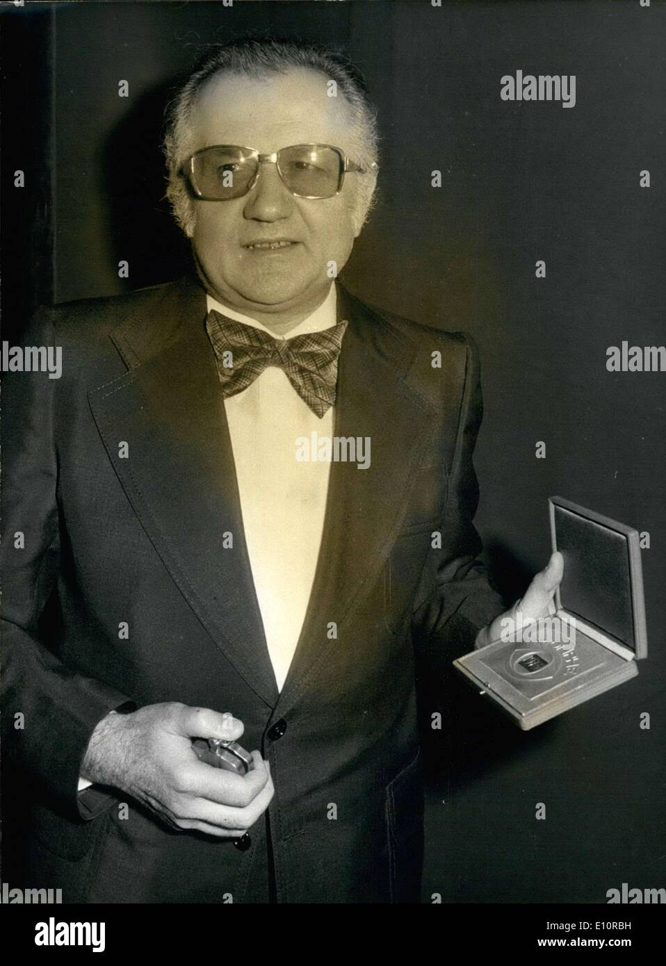 Dec. 14, 1973 - Jean Richard presents the ''Triumph Prize'' that he received for his TV programs at the 20th Paris Theater Festival that was put on by Pierre Louis, Jaqueline Duforest, and Jacques Hetier. It was organized to benefit cinema-supported social work. - Stock Image