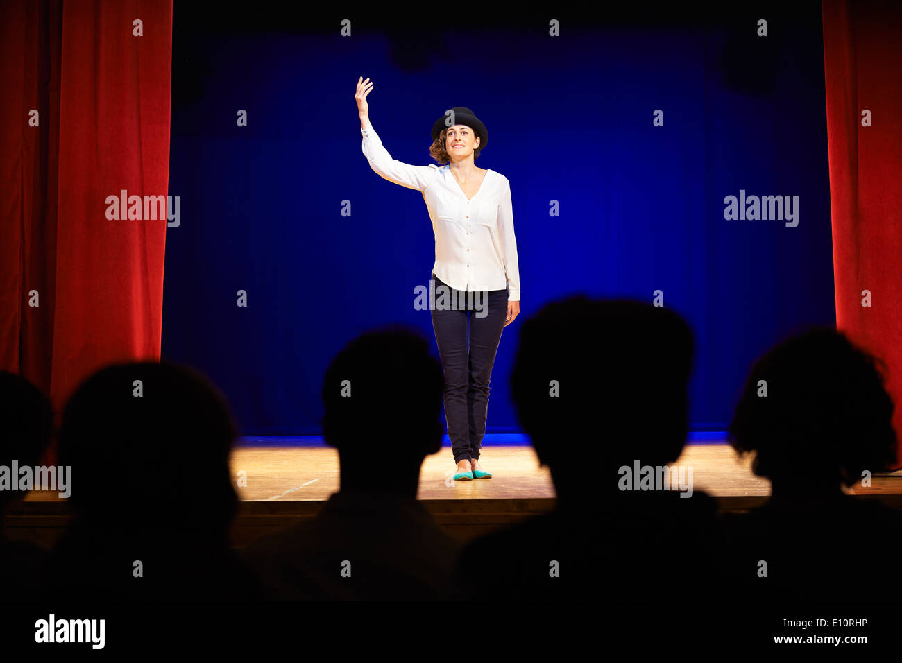 Arts and entertainment in theatre with actress on stage acting in play for audience - Stock Image