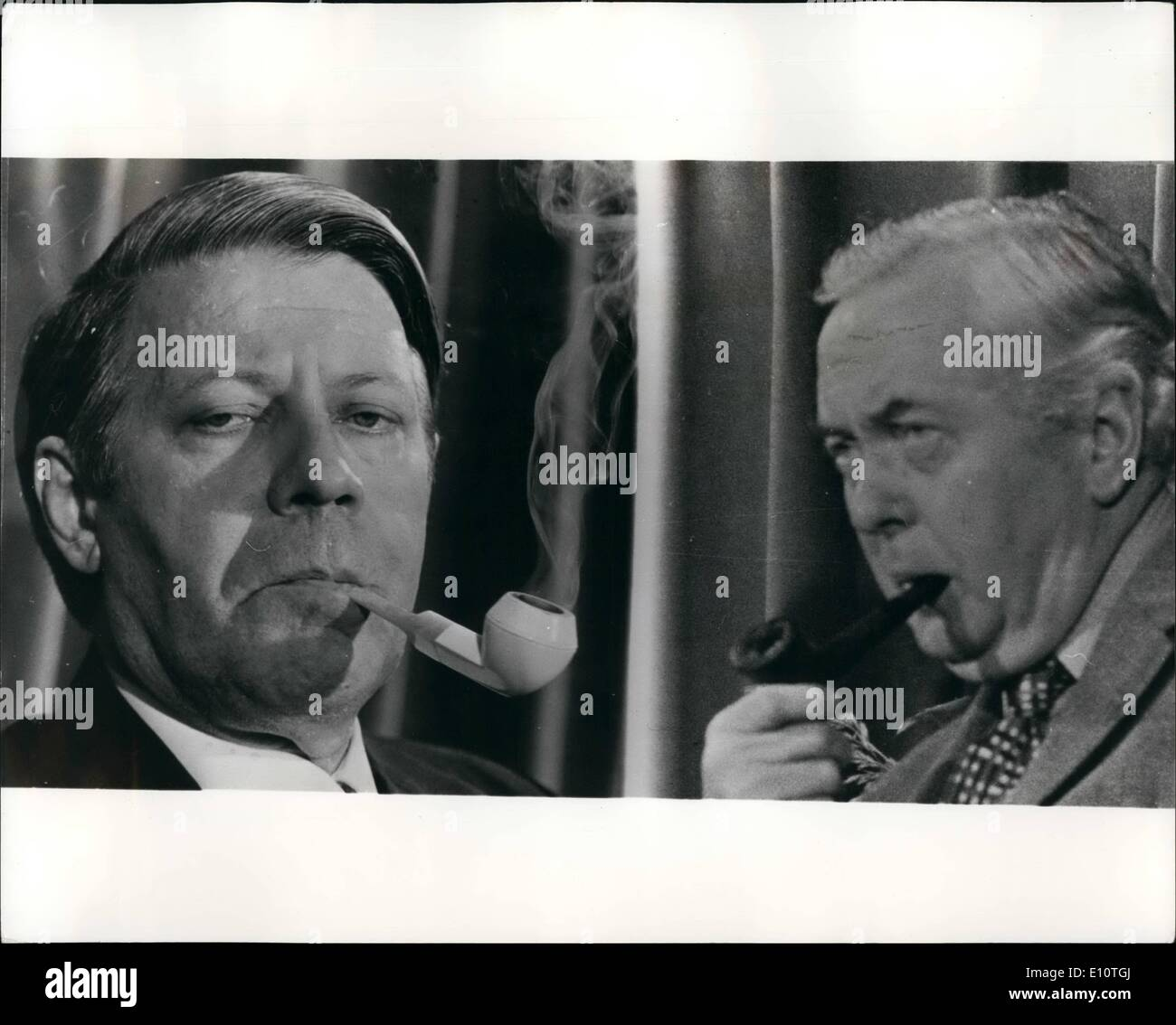 Feb. 02, 1974 - Pipe Smoking Leaders: Pipes were well to the fore in these two pictures, when Herr Heimut Schmidt, the West German Chancellor (left) was seen off by Britain's Prime Minister, Harold Wilson (right), when the Chancellor left for Brussel's yeterday after he had addressed the Labour Party Conference in London. - Stock Image