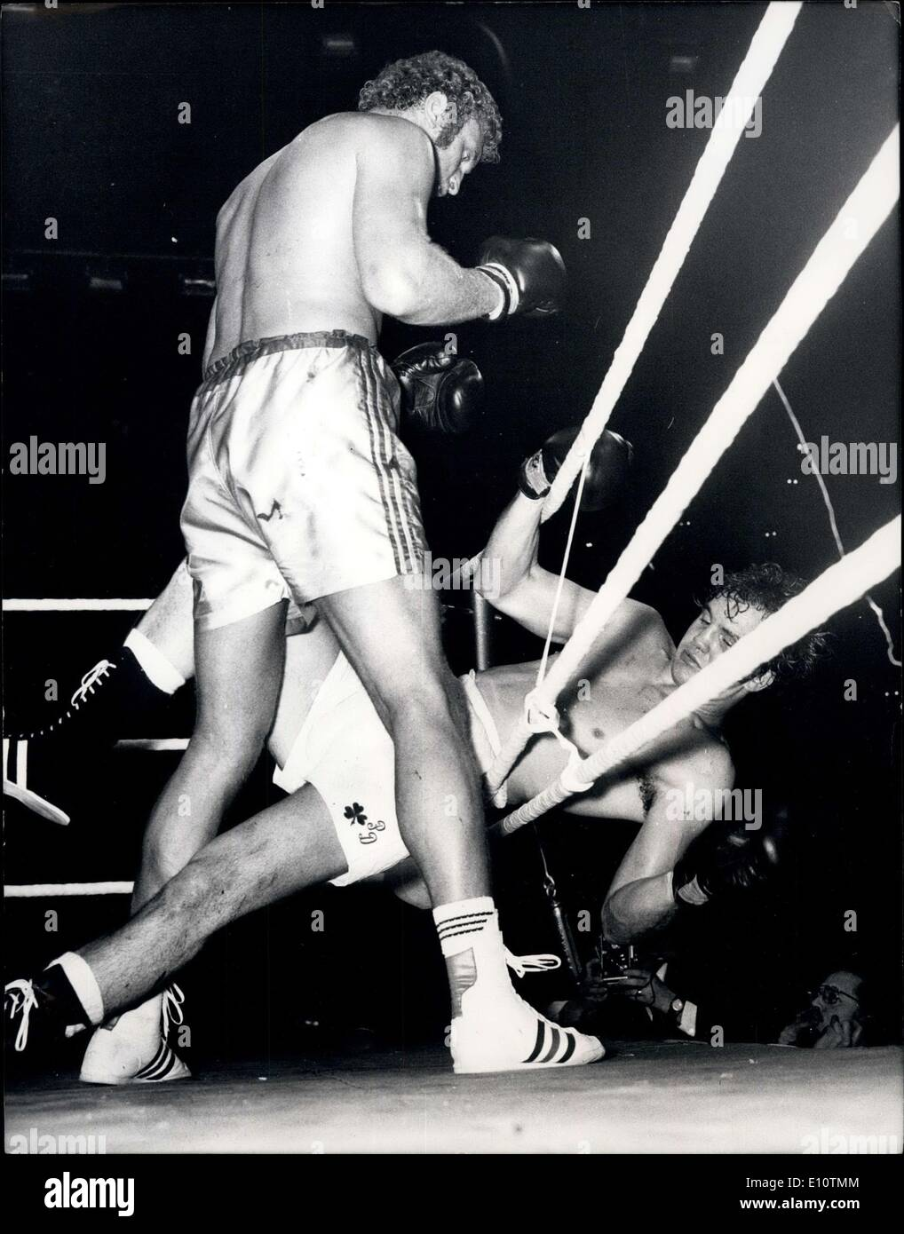 Mar. 13, 1974 - Boxing at the Empire Pool Wembley: Heavyweight's contest. Joe Bugner (Britain) v. 'Irish' Pat Duncan (USA) Photo shows Britain's Joe Bugner stands over 'Irish' Pat Duncan as he crashes through the ropes. - Stock Image