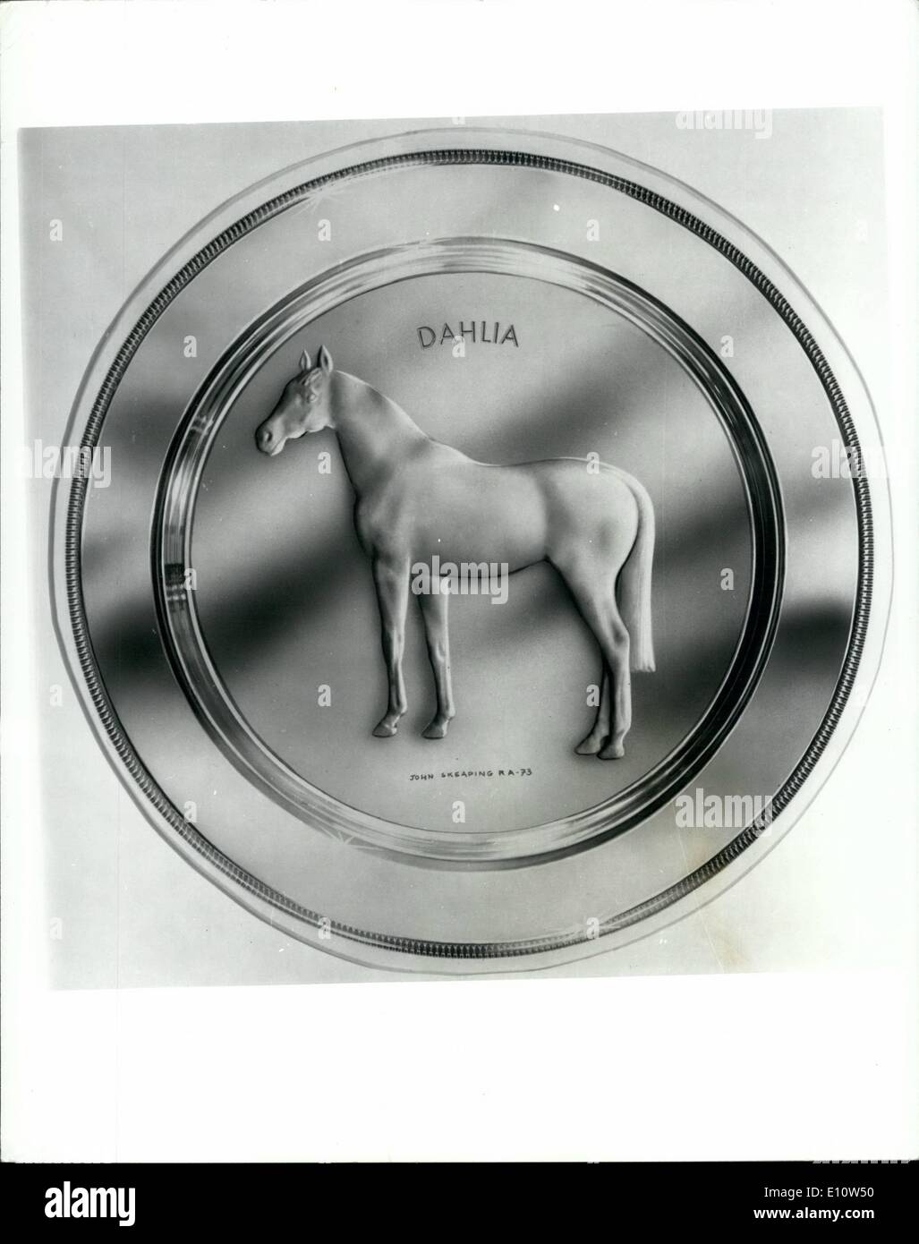 Apr. 04, 1974 - Silver-Gilt plate of filly Dahlia to be presented to its owner : After the second reace at Ascot tomorrow Mr. Nelson Bunker hunt, who was flown from taxes, will receive a silver-gilt plate showing his filly Dahlia, champion racehorse of 1973. The plate, part of a limited has been designed by John Skeaping R.a.Dahlia is shown in has relief. The presentation Will be made in the unsaddlir enclosure by Mr. Jim Joel, the well known racehorse owner - Stock Image