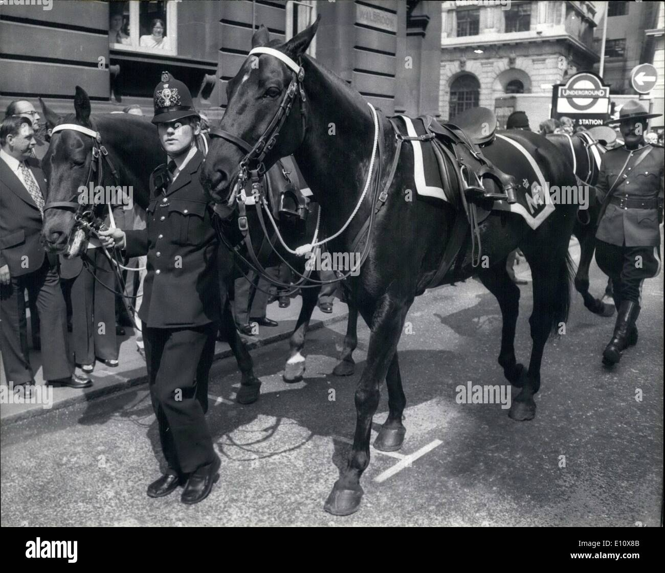 May 05, 1974 - Royal Canadian Mountain Police Visit The City: A detachment of the Royal Canadian Mounted Police today visited the City of London, and at the Mansion House they were inspected by the Lord Mayor Of London, Sir Hugh Wontner, who afterwards received them inside the Mansion House. Photo Shows After dismounting from their horses to g inside the Mansion House, the mounties' Horses were led away by a London policeman. - Stock Image