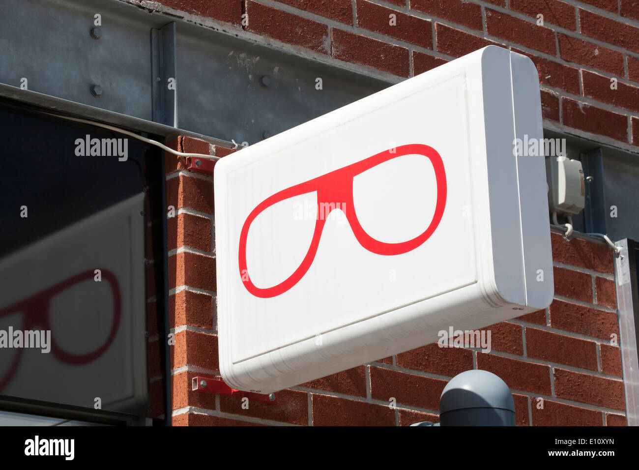 Optician´s sign on building wall, Finland - Stock Image