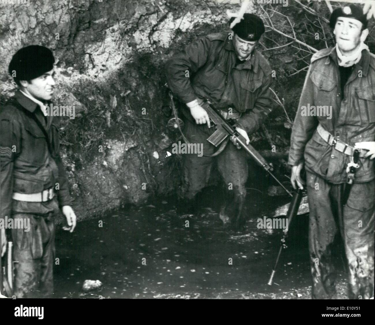 Aug. 08, 1974 - Hunt for IRA escapers: Hundreds of police and soldiers were last night carrying out an intensive hunt for the IRA men who escaped from Eire's Portlaoise Jail on Sunday. Six of the 19 men who escaped left behind a trail of terror as they fled from the man-hunt. Two policemen who spotted the men in a wood outside the village of Courtown in Co. Wexford, were overpowered and tied up,then they raided a holiday bungalow at Ballymoney, five miles away. Photo shows soldiers forage through thick undergrowth and a water-filled ditch. during yesterday's hunt for the escapees. - Stock Image