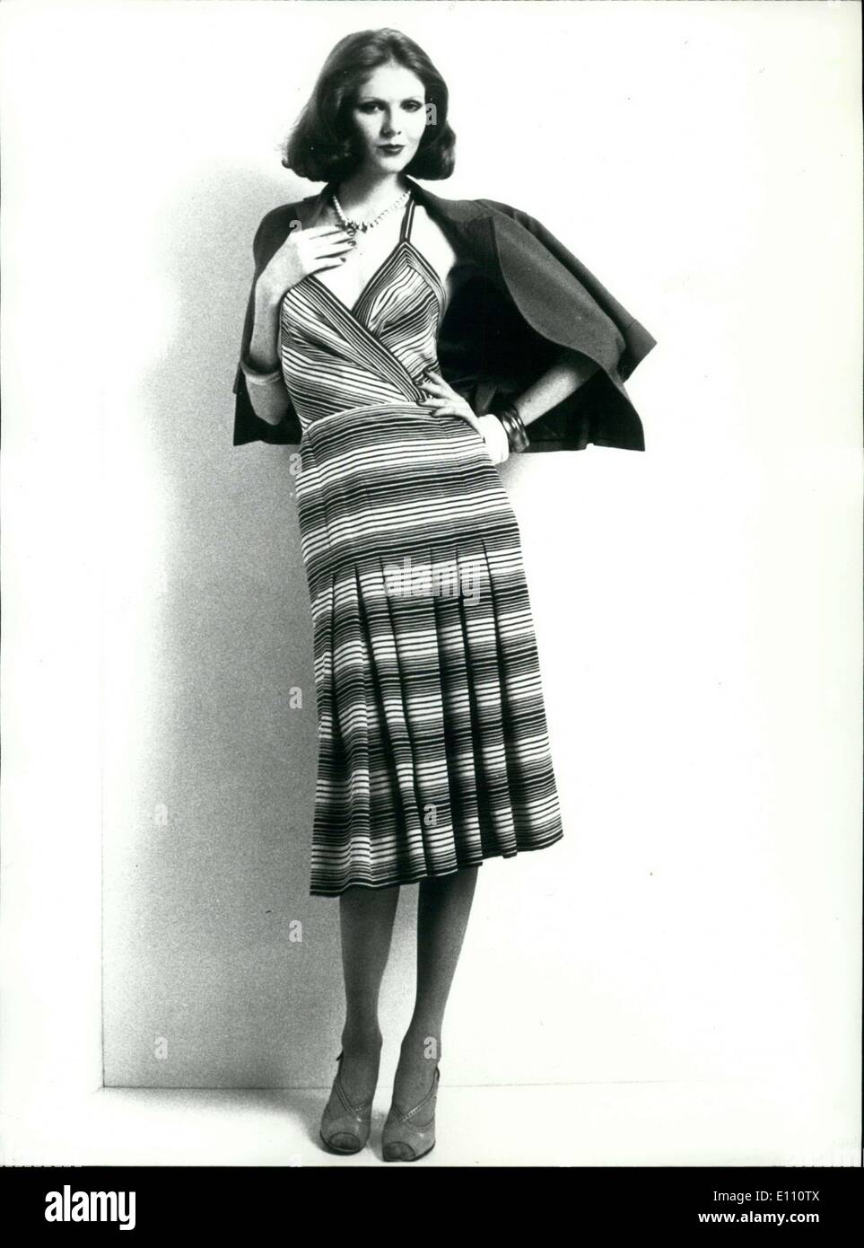 Nov. 20, 1974 - Black, white, and gray striped silk dress with a vest in grey toile. - Stock Image