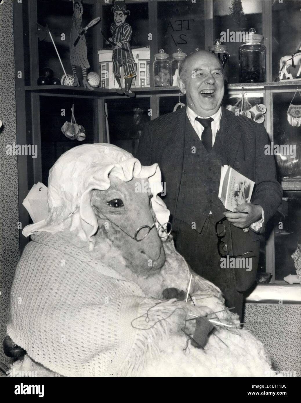Mar. 24, 1975 - Lewis Carroll Exhibition at Hatfield House: Sir John Betjeman today opened an exhibition depicting the life, writings and diverse interests of Lewis Carroll (the Rev.Charles Lutwidge Dodgson, 1832-1898), author of ''Alice in Wonderland'' and ''Through the Looking Glass''. held in the newly-restored Riding School at the Marquess of Salisbury.The exhibition, which opens to the public tomorrow, will remain open until October 5th. Photo Shows Sir John Betjeman is amused when looking at a model of the Knitting Sheep - when he toured the exhibition today. - Stock Image