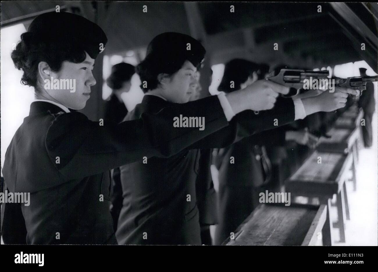 Apr. 04, 1975 - Japan Policewomen: While no decision has been made whether to arm the policewoman or not, they have undergone revolver training at the shooting range, and are prepared to go armed if required. - Stock Image