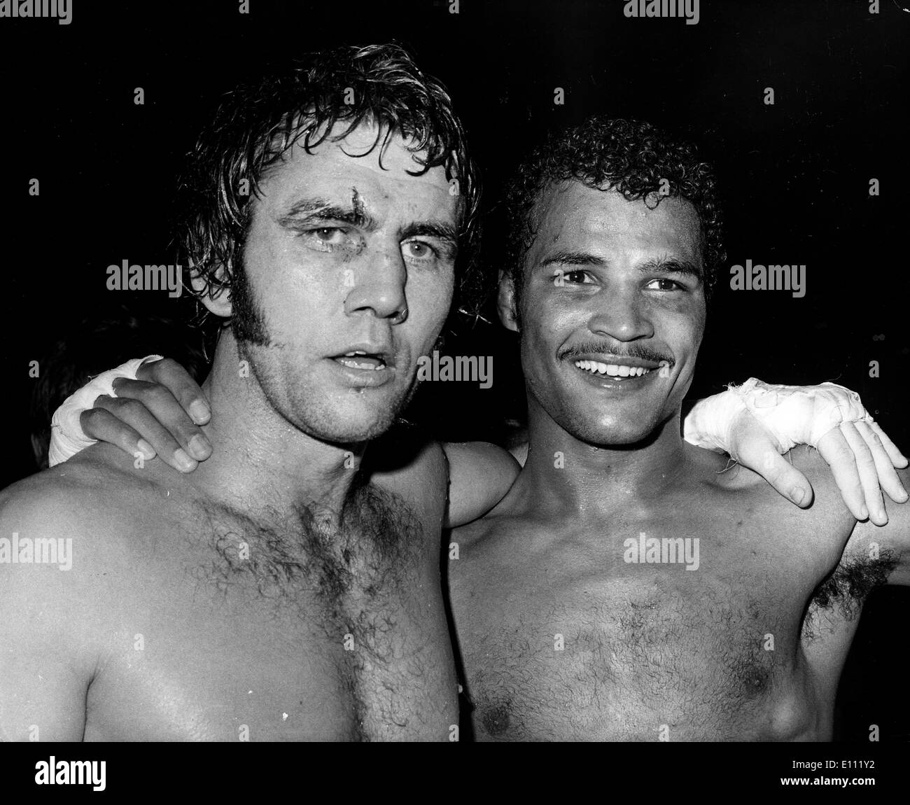 Jan. 01, 1975 - Circa 1970s, location unknown. JOHN CONTEH (R) (born 27 May 1951 in Toxteth, Liverpool, England) is a British former boxer who was world light-heavyweight boxing champion.. - Stock Image
