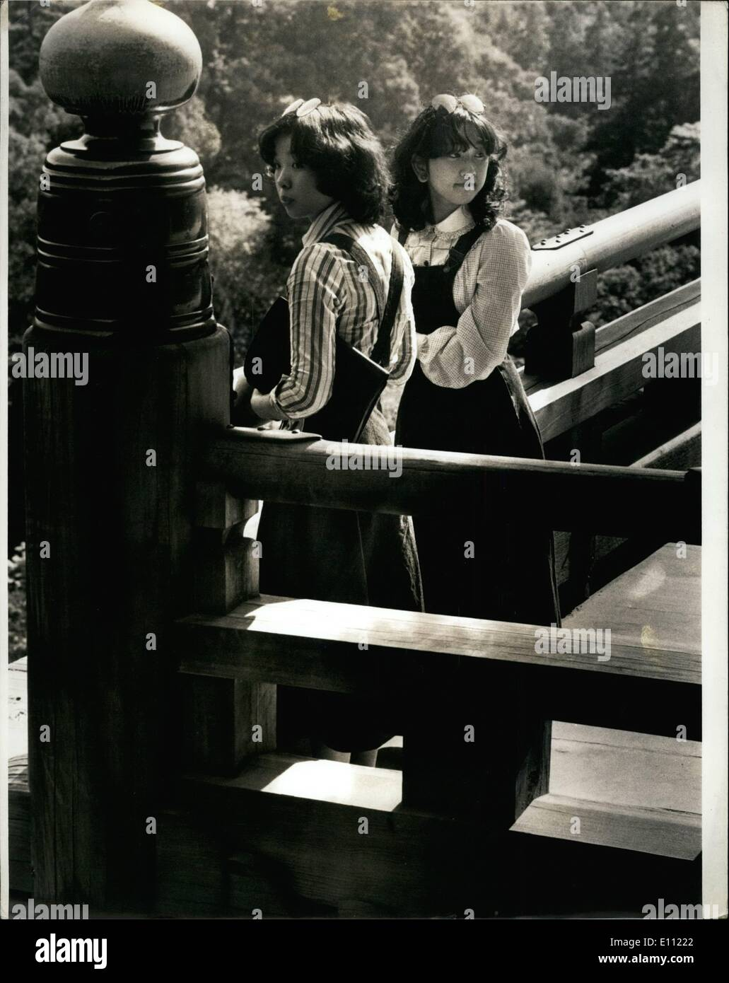 Apr. 04, 1975 - Japanese students visiting an Ancient shrine in Kyoto Japan (dressed in denim skirts) ne - Stock Image