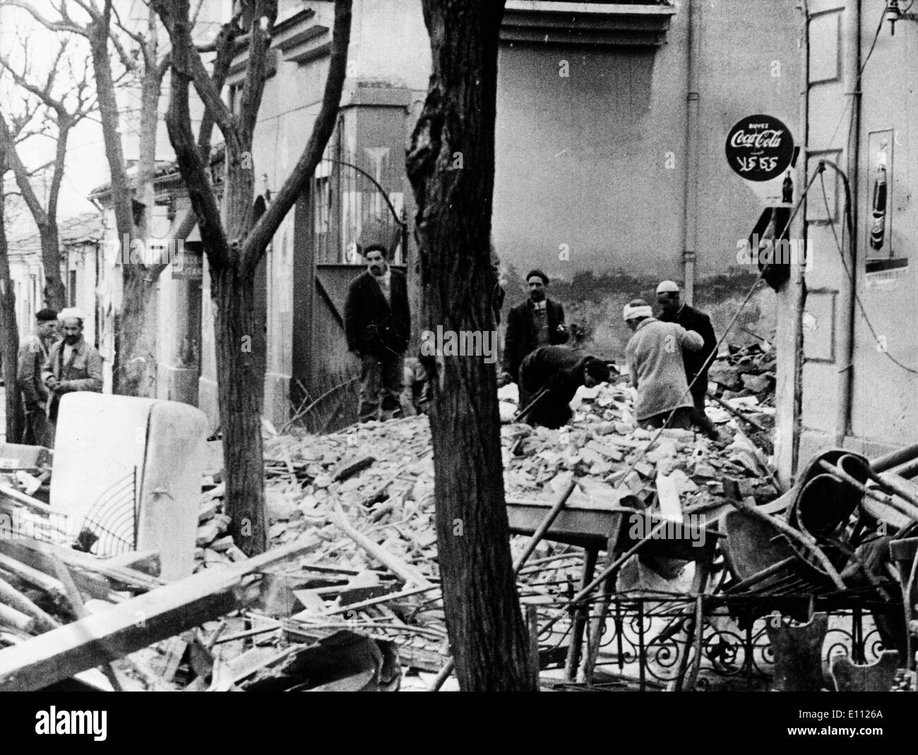Muslims clean market place after bombing - Stock Image