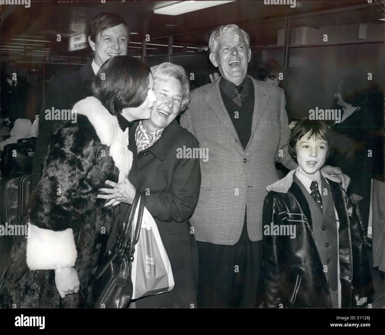 Feb. 02, 1975 - Garfield Todd and Wife Arrive from Rhodesia. The former Rhodesian Prime Minister Garfield Todd, who has been under restirction for the past four years, arrived at London Airport early this morning. He was accompanied by his wife, Grace, and they were met at the airport by Mr. Garfield's daughter, Judith, and her husband who is living in London. Photo Shows:- A happy Garfield Todd, on right, seen with his grandson, son of Judith Todds husband Mr. Acton, Judith Todd seen kissingher mother Grace, standing behind them is Mr. Acton, Judith Todds husband. Mr - Stock Image