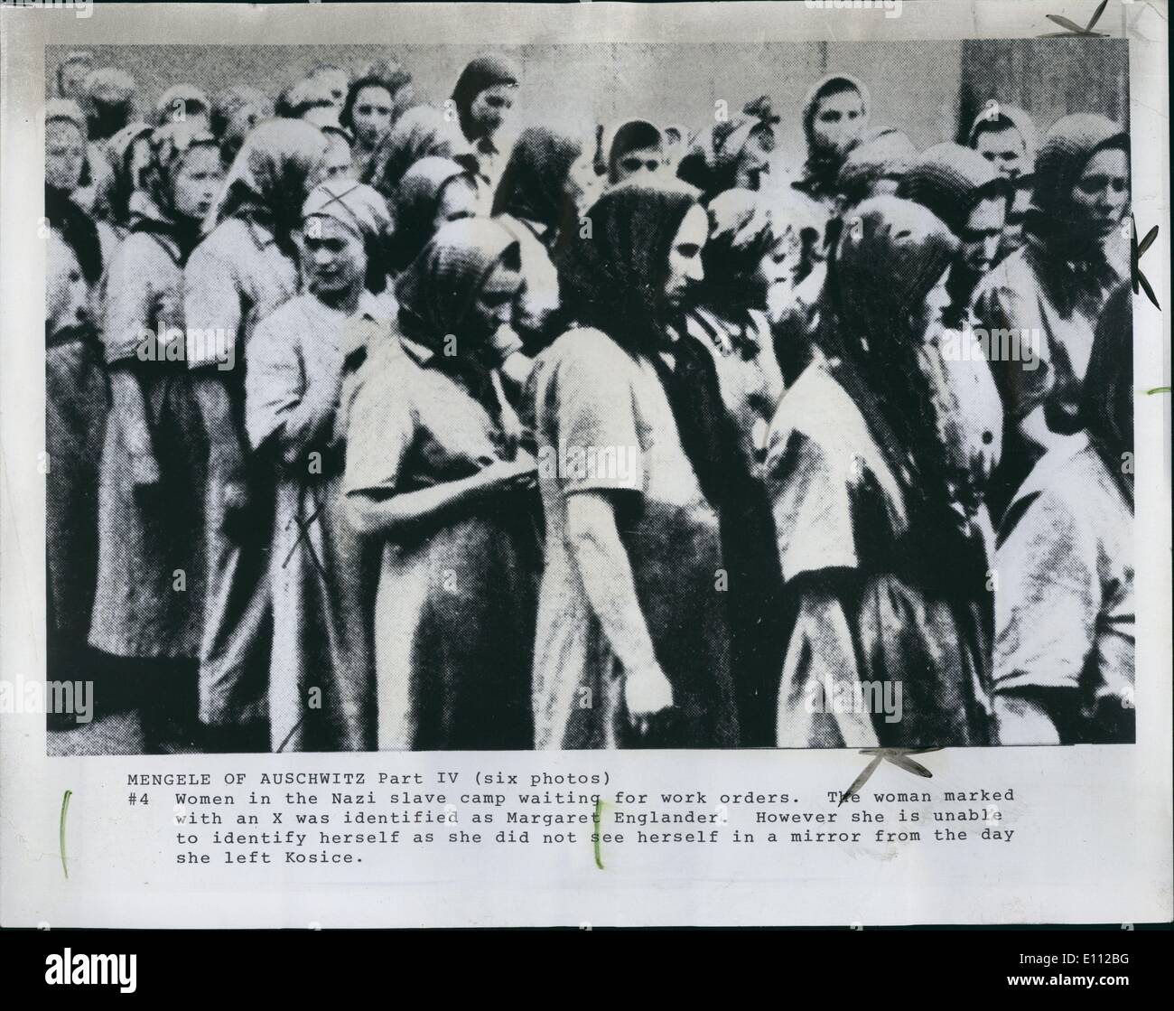 May 05, 1975 - Women in Auschwitz - Birkenau wait for work orders. The woman marked with an X was identified as Margaret F.Englander. However, she is unable to identify herself as she did not see herself in a mirror until near the end of her stay at the concentration camp. - Stock Image