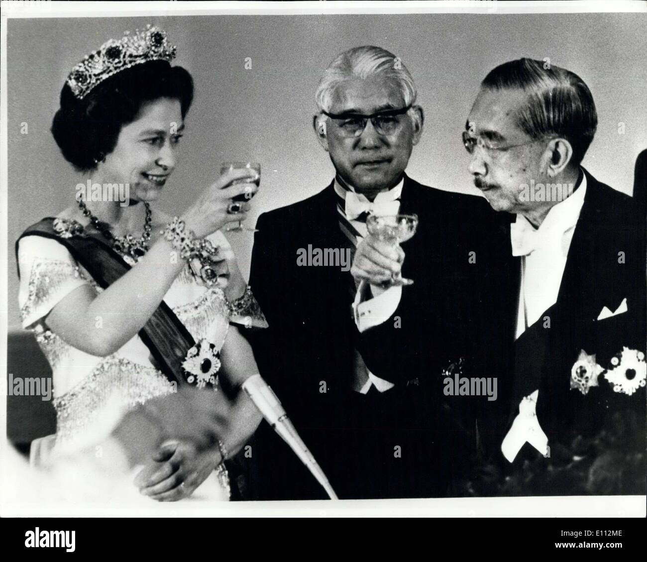 May 10, 1975 - The Emperor Toasts The Queen: The Queen is being greeted with a toast by Emperor Hironito of Japan in Tokyo when - Stock Image