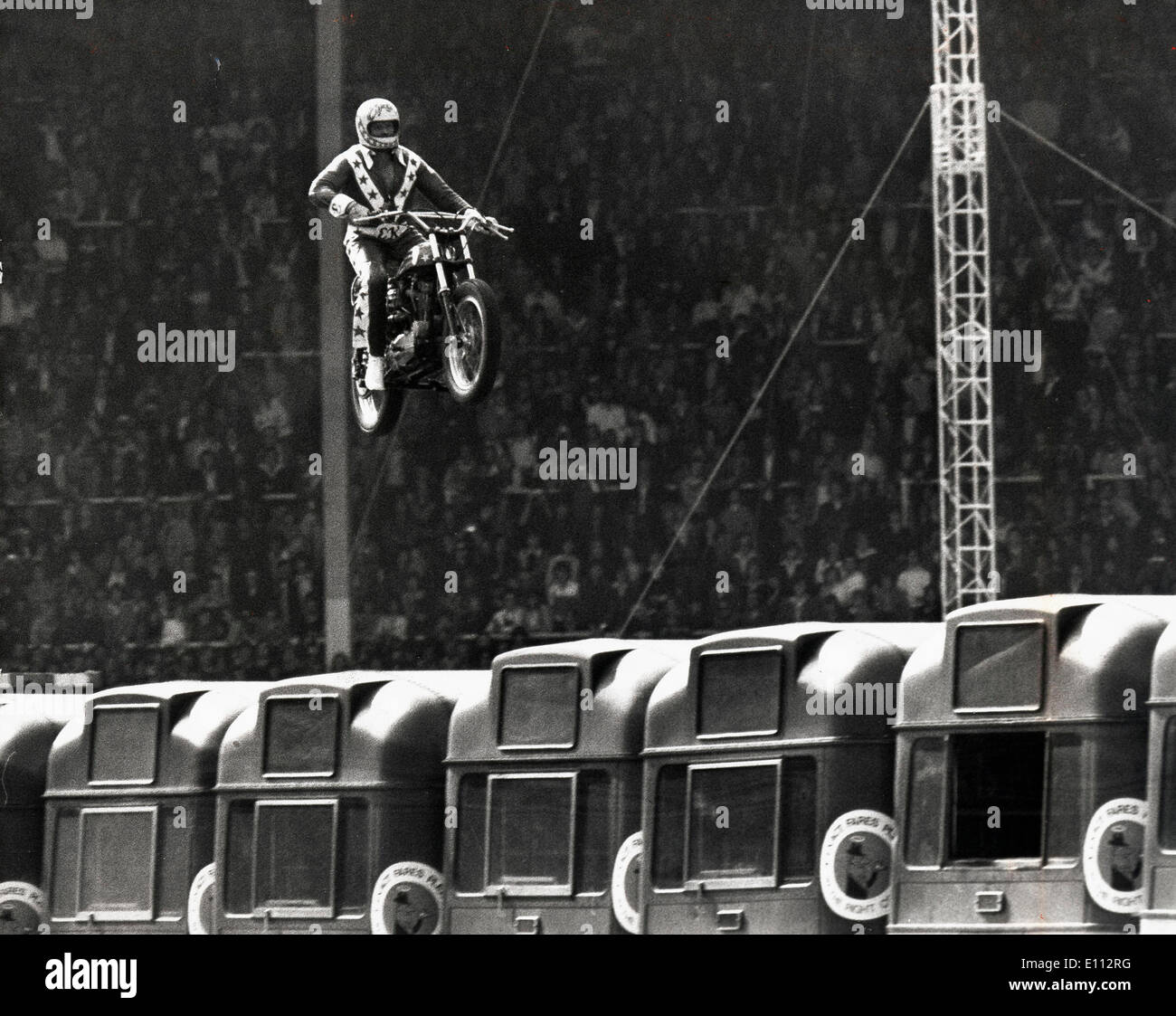 Daredevil Evel Knievel crashes after bus jump - Stock Image