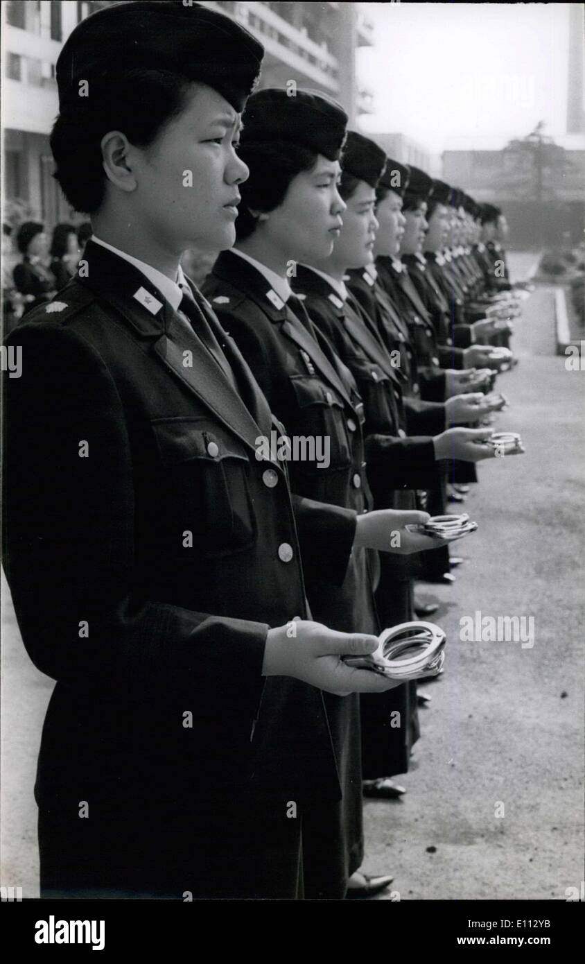 Jun. 23, 1975 - Japan Policewomen: The Policewomen show their steel handcuffs for an inspection by their officer. - Stock Image