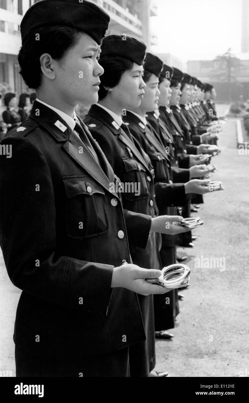 Jun 23, 1975; Tokyo, Japan; While no decision has been made whether to arm the policewomen or not, they have undergone revolver - Stock Image