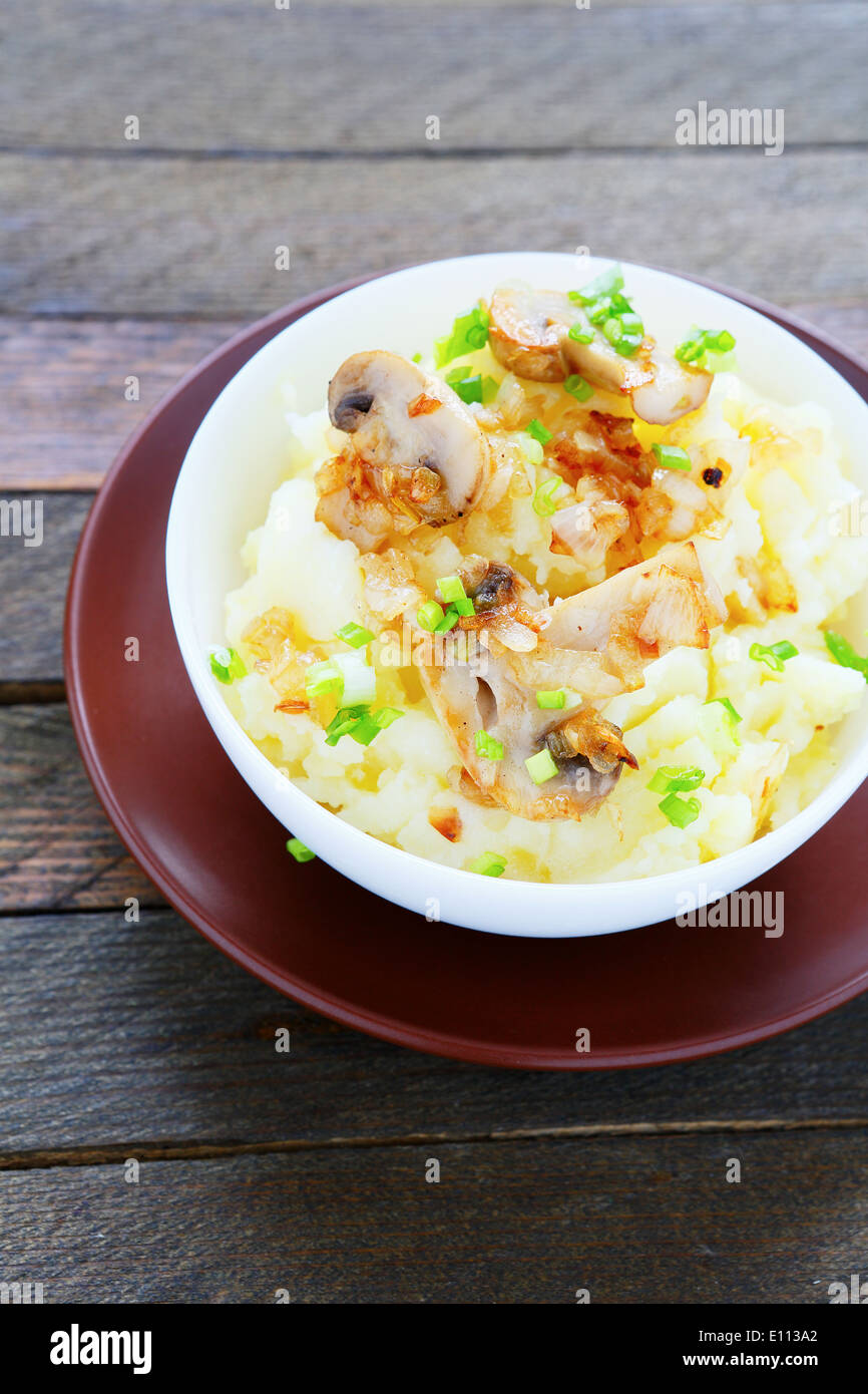 flavored potatoes with fried mushrooms, food closeup - Stock Image