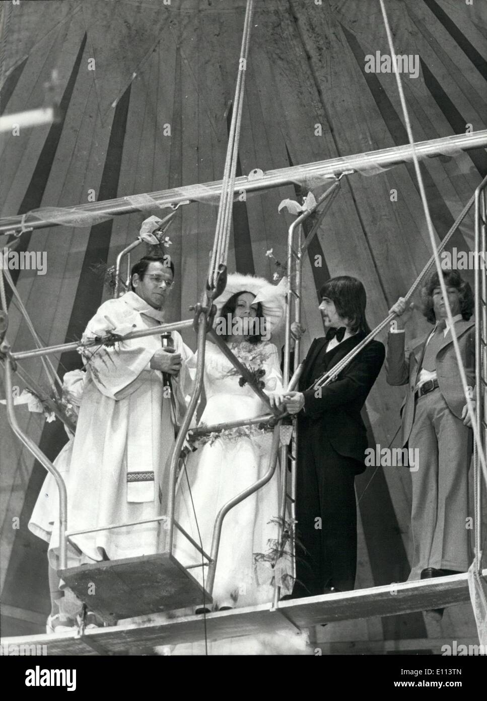 Jul. 07, 1975 - They are in their ''Seventh heaven'' - newly weds trapeze artistes Francis Martin Kora, 24, from the USA and has lovely partner Carole Fiallo, 21, from cape town, s. Africa, The priest is father jean boudeau. They decided on their novel high flying wedding ceremony whilst working with the pinder jean-Richard circus at Nantes. in France. - Stock Image