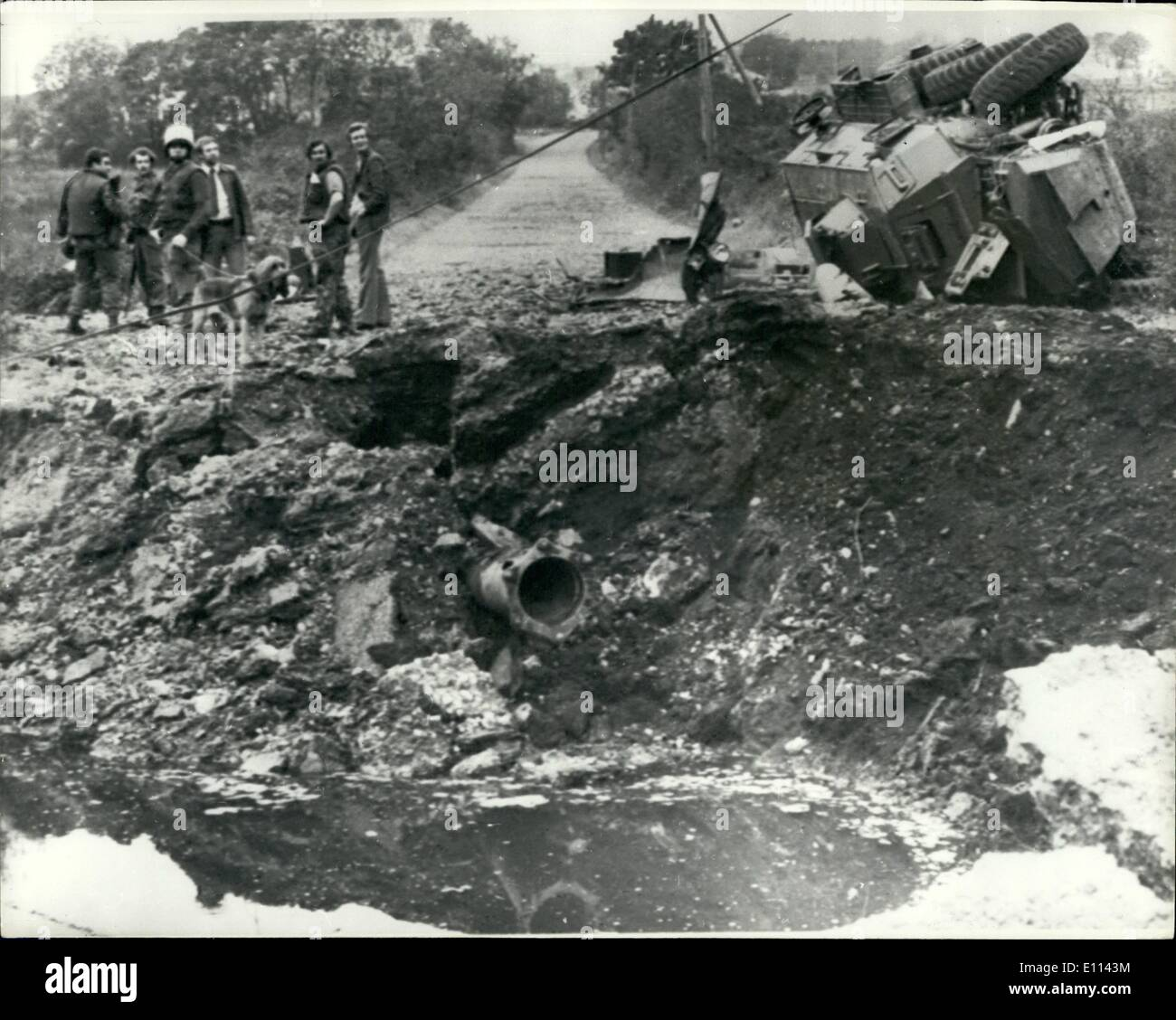 Oct. 10, 1975 - A BRITISH SOLDIER IS KILLED WHEN A BOMB BLOWS UP AN ARMY SARACEN IN ARMAGH: A radio-exploded 400-lb bomb blew an Army Saracen on its side in open country four miles from Crossmaglen, South Ammagh yesterday, killing one soldier and seriously injuring two others and a policeman in the six-man military patrol. The provisional IRA promptly claimed responsibility. Photo shows the overturned Arm Saracen lying on the rim of a huge crater after the 400-lb bomb exploded on a road four miles from Crossmaglen, South Armagh, yesterday. - Stock Image