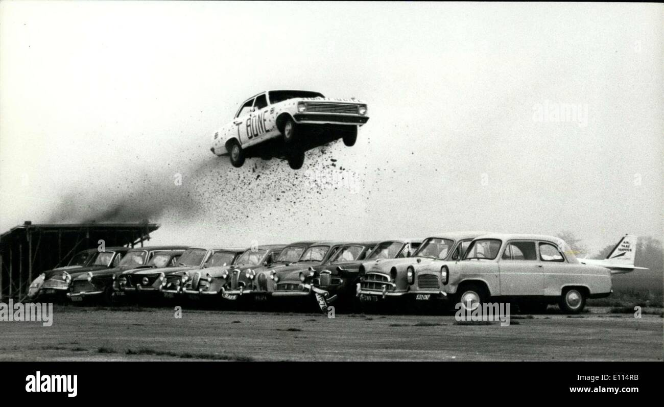 Nov. 14, 1975 - Stunt Driver Keith (T-Bone) Bowen Jumps Over 13 Parked Cars To Break The World Record: Stunt driver Keith (T-Bone) Bowen broke the world record today by driving his car in a leap over 13 parked cars at the Thruxton Racecourse, near Andover, hants. This feat was filmed for the new BBC 1 variety series 'Saturday Special' which will be shown on Nov 22. Photo shows Keith T-Bone Bowen seen during his record leap on the Thurxton Racecourse today. - Stock Image