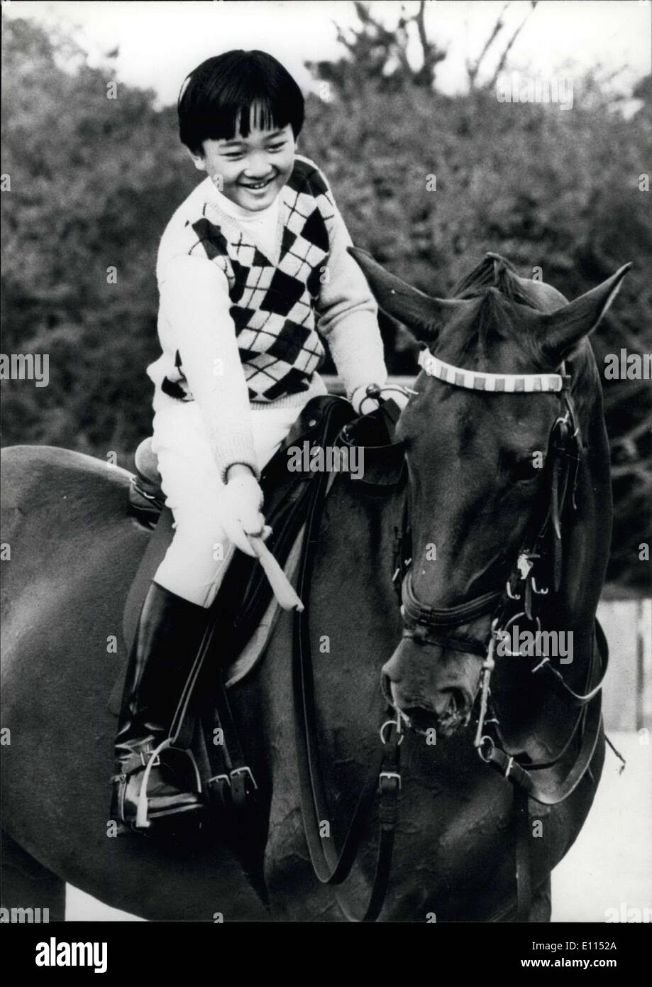 Dec. 07, 1975 - Prince Aya rides on his birthday.: Prince Aya, second son of the Crown Prince and Princess of Japan, feeds his horse a carrot after a ride through the park of his home, the Togu Palace in Tokyo on his 11th birthday. - Stock Image