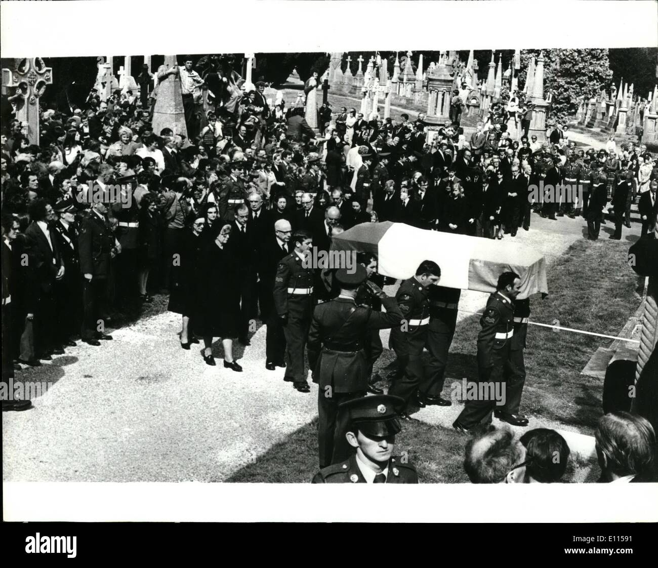 Sep. 04, 1975 - September 4th, 1975 The funeral of Eamon De Valera former President of the Irish Republic. The funeral take the place in Dublin on Tuesday last of Mr. Eamon De Valera, the former Irish President who outlived a British death sentence almost 60 years ago for his part in the 1916 Dublin Easter uprising. he died last week at the age of 92. Photo Shows: Members of Eamon De Valera's family, and close relatives follow the Irish tri-colour covered coffin to the family grave at Glasnevin Cemetery, Dublin. - Stock Image