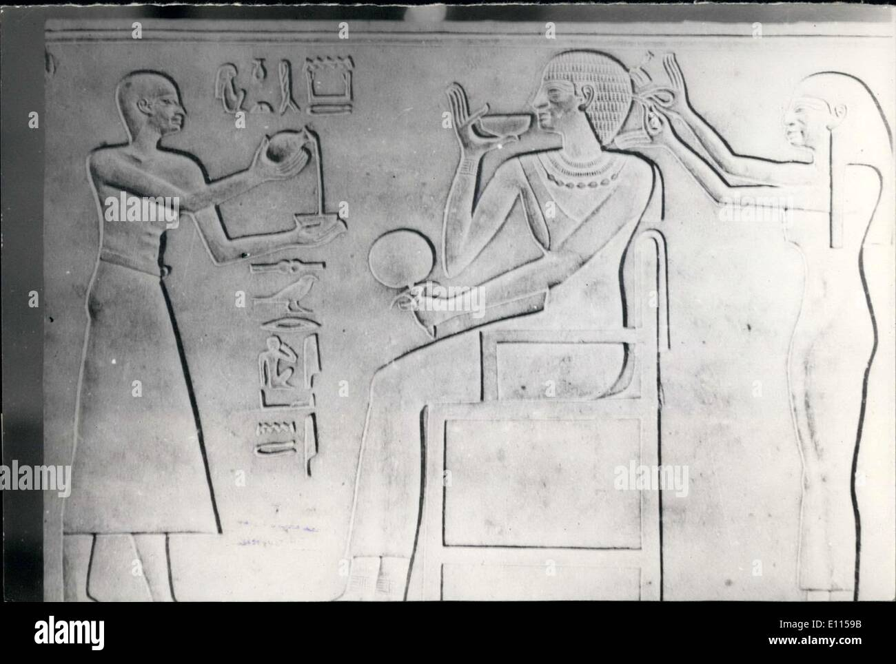 Sep. 09, 1975 - Modern Woman of Ancient Times: A drawing on papyrus showing Queen Clot, wife of Farao amen Hoteb, making her make up. A maid is dressing her hair, and onother fouring milk in a cup for her to driknk during her make-up. She drinking some beverage and holding a mirror in her hand. - Stock Image