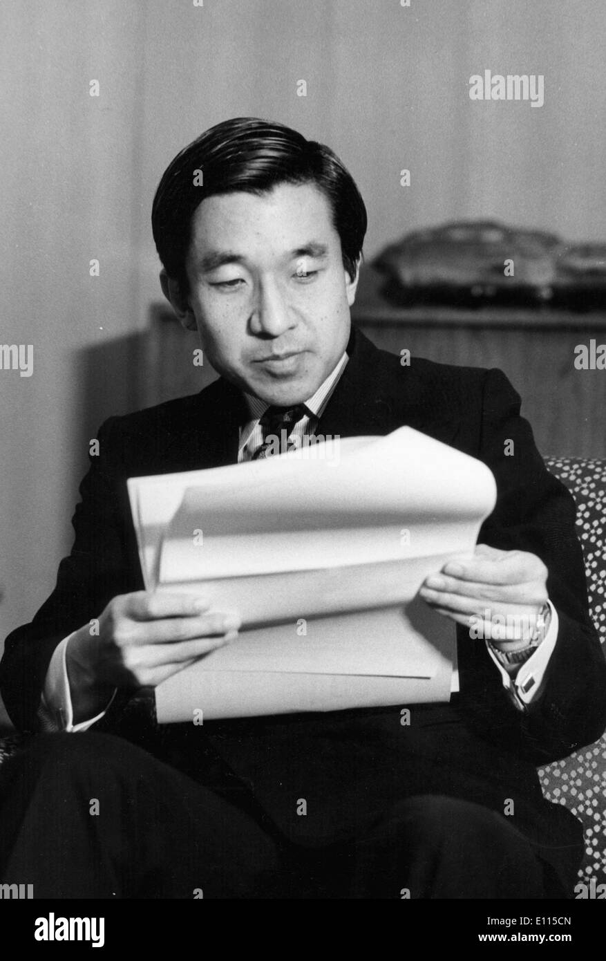 Dec 23, 1975; Tokyo, Japan; Crown PRINCE AKIHITO of Japan, who is 42 on December 23, 1975, is shown studying reports of the Okinawa Expo '75 at his residence Togu Palace in Tokyo, on his brithday. - Stock Image