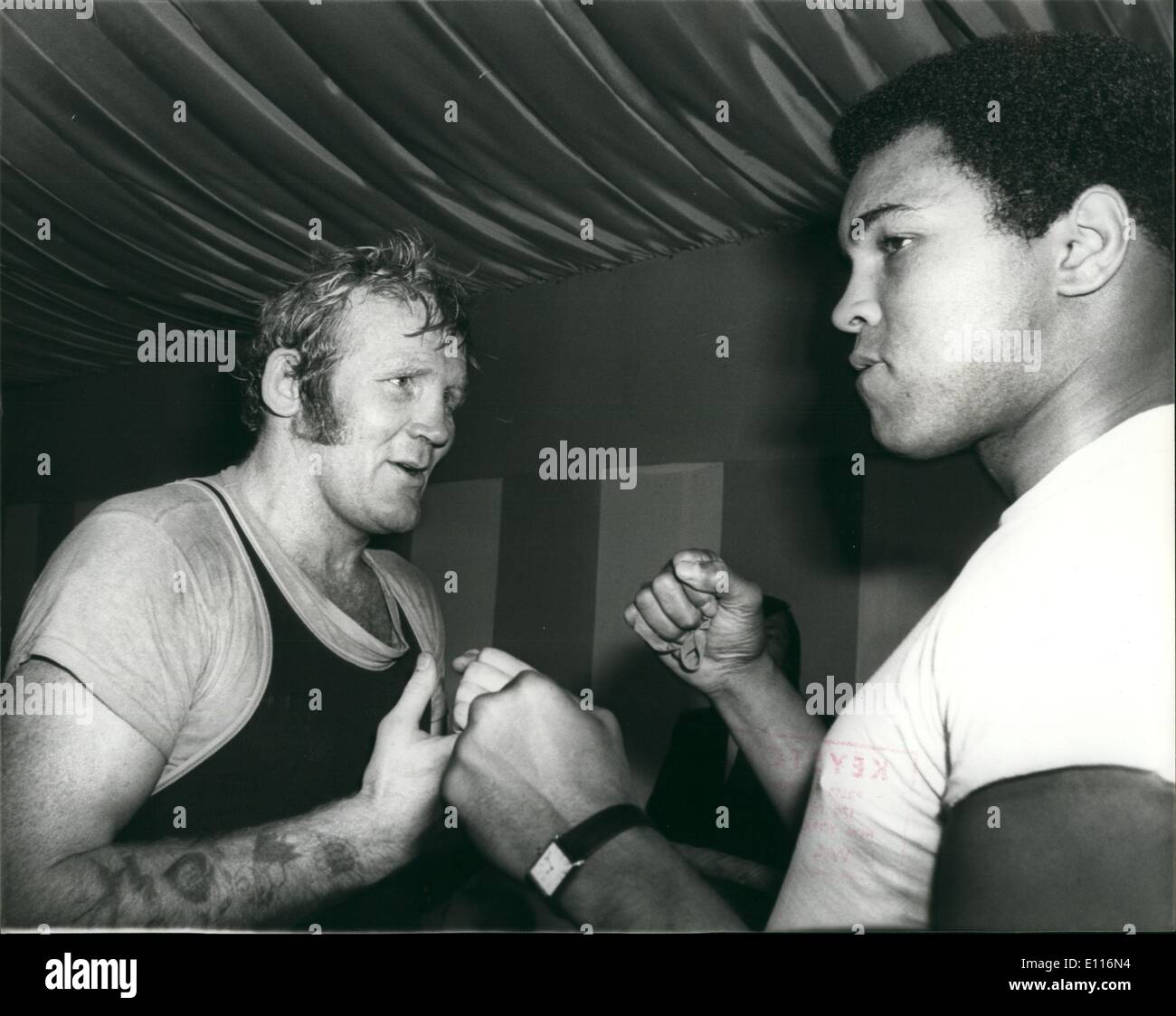 Mar. 03, 1976 - Muhammad Ali seen in the ring with Richard Dunn the British Heavy weight Champion during his visit to the gym at Quagline's today. - Stock Image
