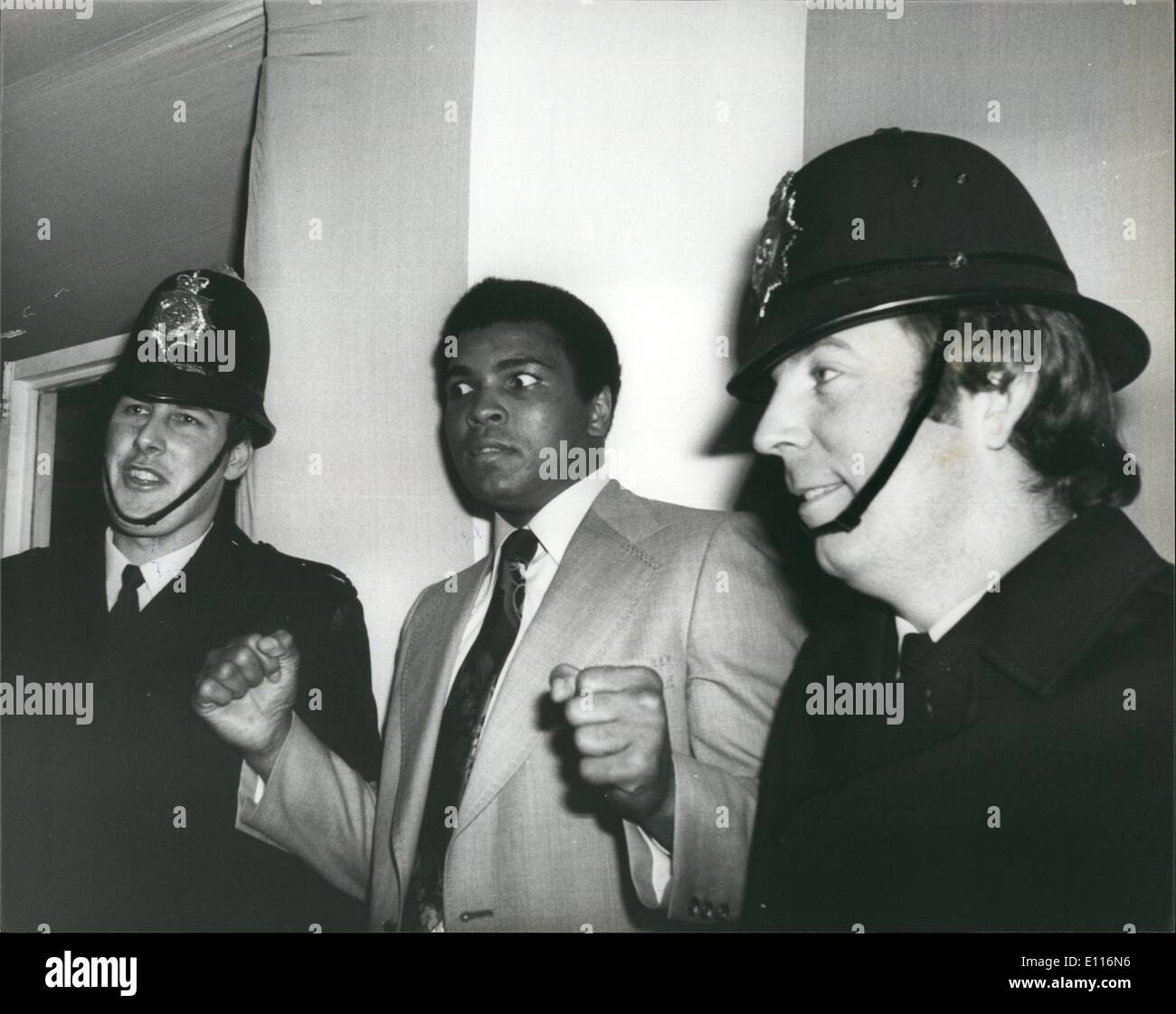 Mar. 03, 1976 - Muhammad Ali Meet British Heavyweight Champion Richard Dunn at Quaglino's Gym in London Muhammad Ali has the law to help him out when his visited the gym at Quaglino's today. - Stock Image