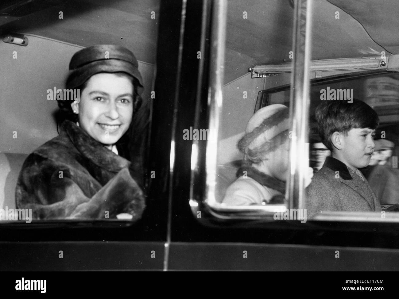 Queen Elizabeth II riding in car with children - Stock Image