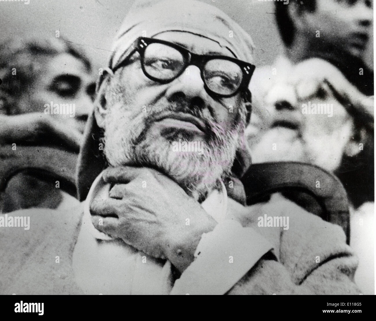 Mr. RAJ NARAIN listens to a speaker at a rally. Exact date unknown. - Stock Image