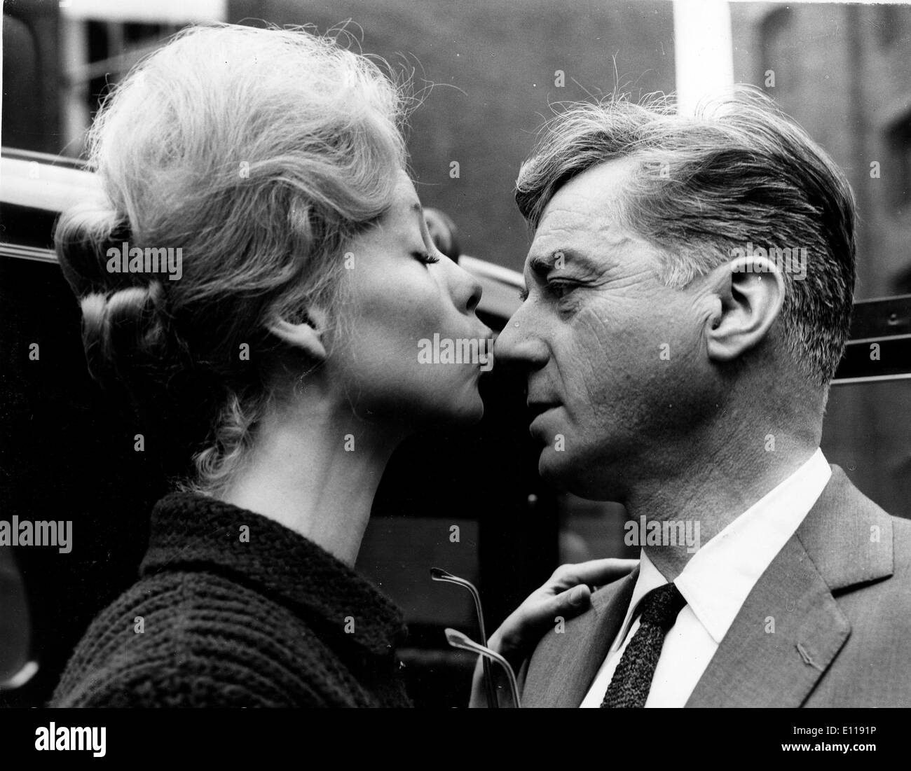 Actor Claude Dauphin greets wife at station Stock Photo