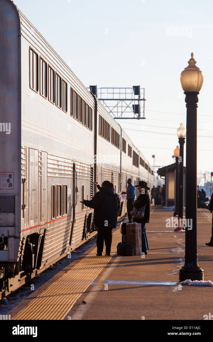 An Amtrak passenger train arrives at the Galesburg, IL depot. Stock Photo