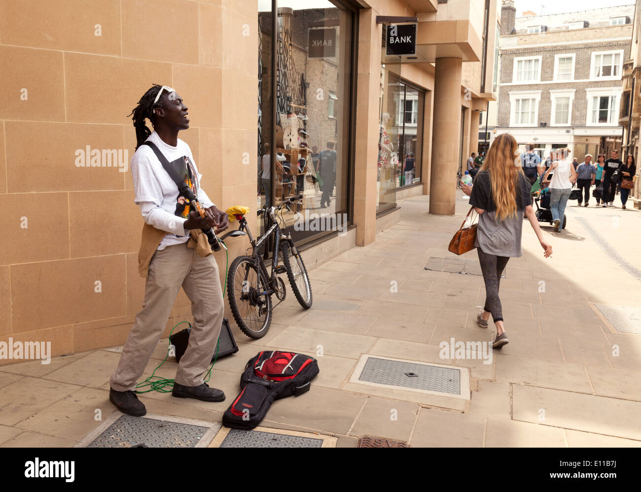 A black street performer musician playing a guitar, Cambridge, UK - Stock Image