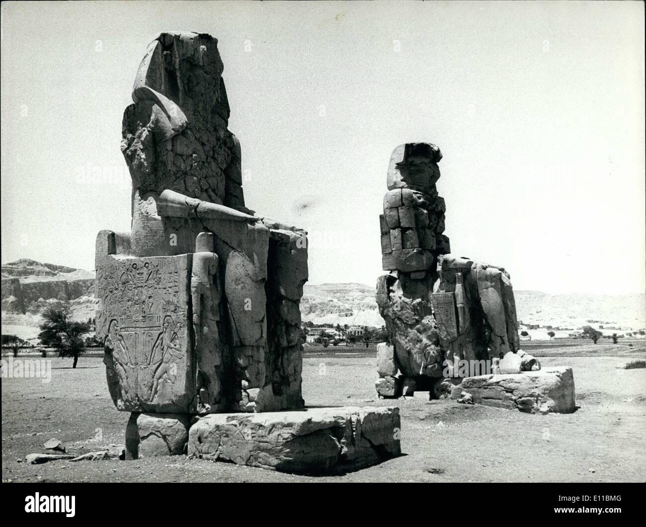 Aug. 08, 1976 - The statues of Luxor will be renovated. The statues of Memnon near Luxor in Southern Egypte will be renovated, as the lower parts have been damaged by the water, led on the fields. The statues are 17 meters high and made from a single stone. They are said to show Amenophis III. - Stock Image