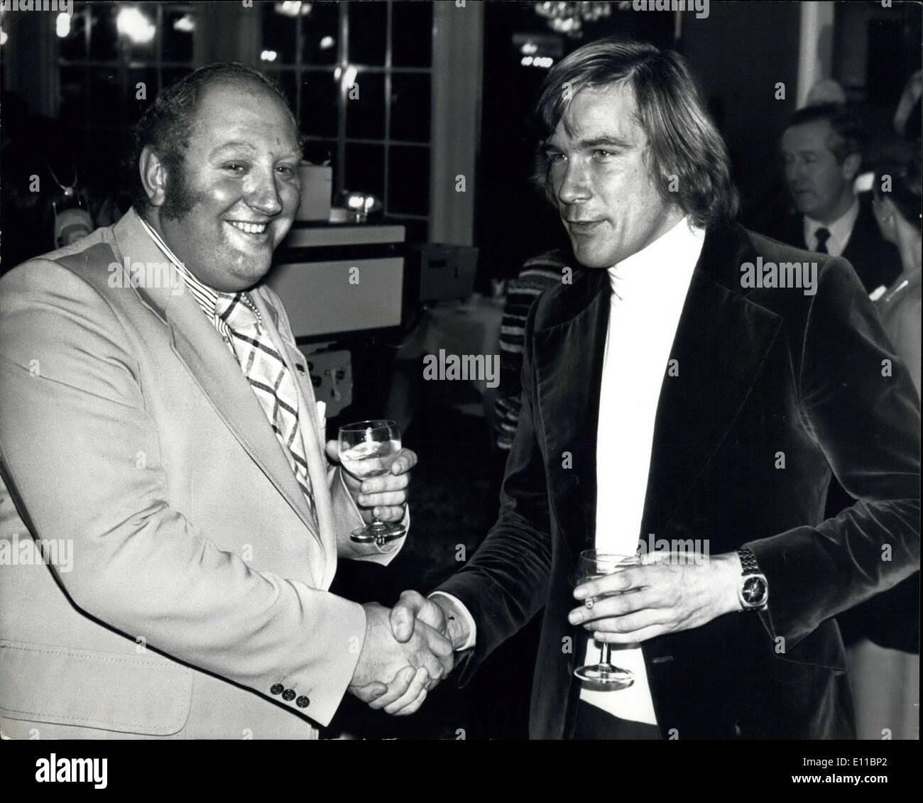Dec. 06, 1976 - James Hunt and Gerry Marshall are still good friends: World Champion racing driver, James Hunt was involved in an incident with saloon car racing driver Gerry Marshall on Friday last at the British racing Driver's Club ball at London's Dorchester Hotel The incident arose when Gerry Marshall went to introduce a friend to James Hunt on the next table. As Gerry turned round to James the glass of gin and tonic that Gerry was holding was tipped into his face, the glass cutting his forehead. James Hunt has apologized to Gerry Marshall who was ready to forgive and forget - Stock Image