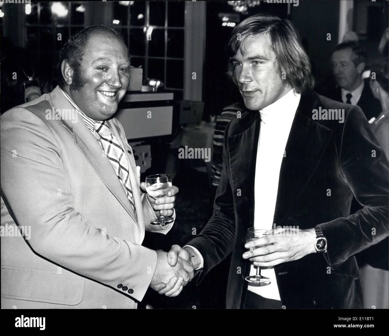 Dec. 12, 1976 - James Hunt and Gerry Marshall are Still Good Friends: World champion racing driver, James Hunt was involved in an incident with saloon car racing driver Gerry Marshall on Friday last at the British Racing Drivers Club ball at London's Dorchester Hotel. The incident arose when Gerry Marshall went to introduce a friend to James Hunt on the next table. As Gerry turned round to James the glass of gin and tonic that Gerry was holding was tipped into his face, the glass cutting his forehead. James Hunt has apologized to Gerry Marshall who was ready to forgive and forget - Stock Image