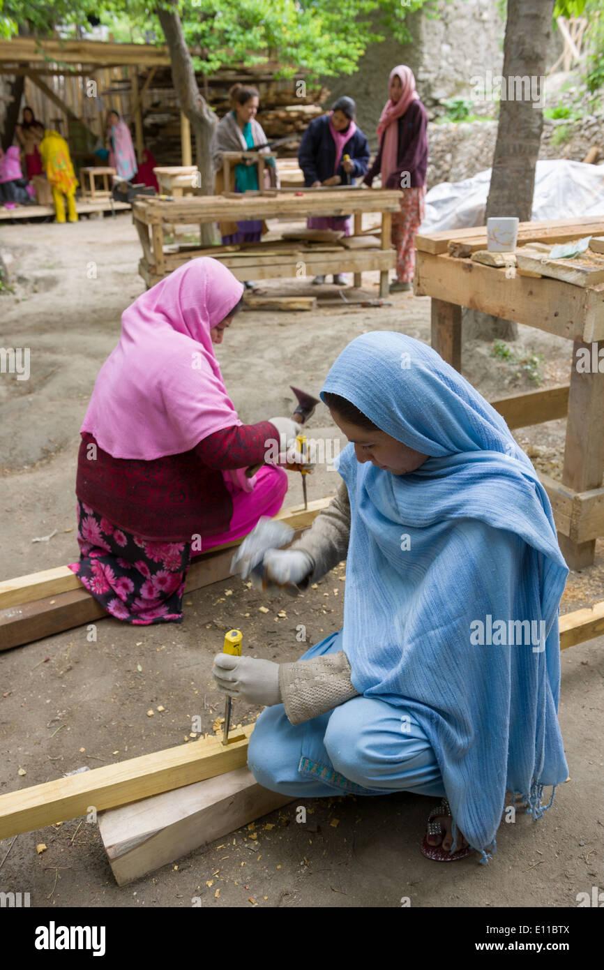 Women using chisels at a charity teaching Pakistani women carpentry, Altit Village, near Karimabad, Hunza Valley, Gilgit-Baltistan, Pakistan - Stock Image