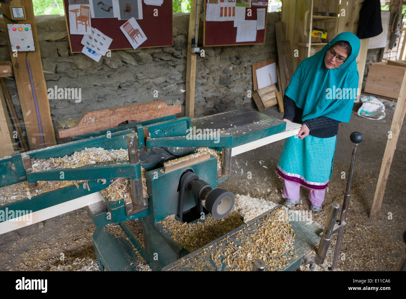 Woman using a power tool at a charity teaching Pakistani women carpentry, Altit Village, near Karimabad, Hunza Valley, Gilgit-Baltistan, Pakistan - Stock Image