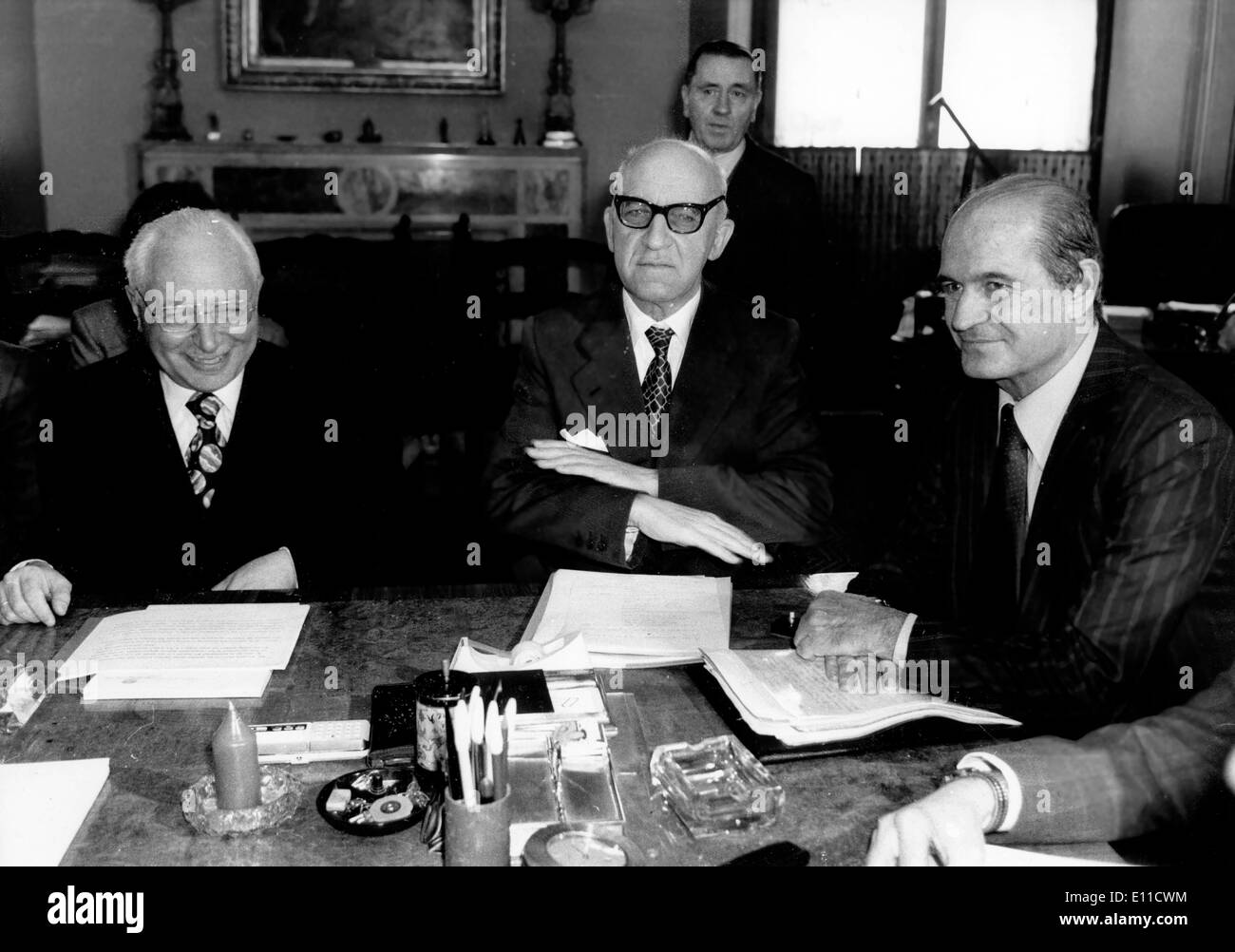 Mar 11, 1977; Rome, Italy; The rise of Italian llire against the weekend U.S. dollar is the subject of the meeting of top bankers at the Ministry of Finance in Rome, and the effect it will have on the Italian economy. The picture shows (from L-R) MARIO ERCOLANI, Vice director of the of the Bank of Italy, PAOLO BAFFI, Governor of the Bank of Italy and GAETANO STAMMI, Minister of the Treasury. - Stock Image