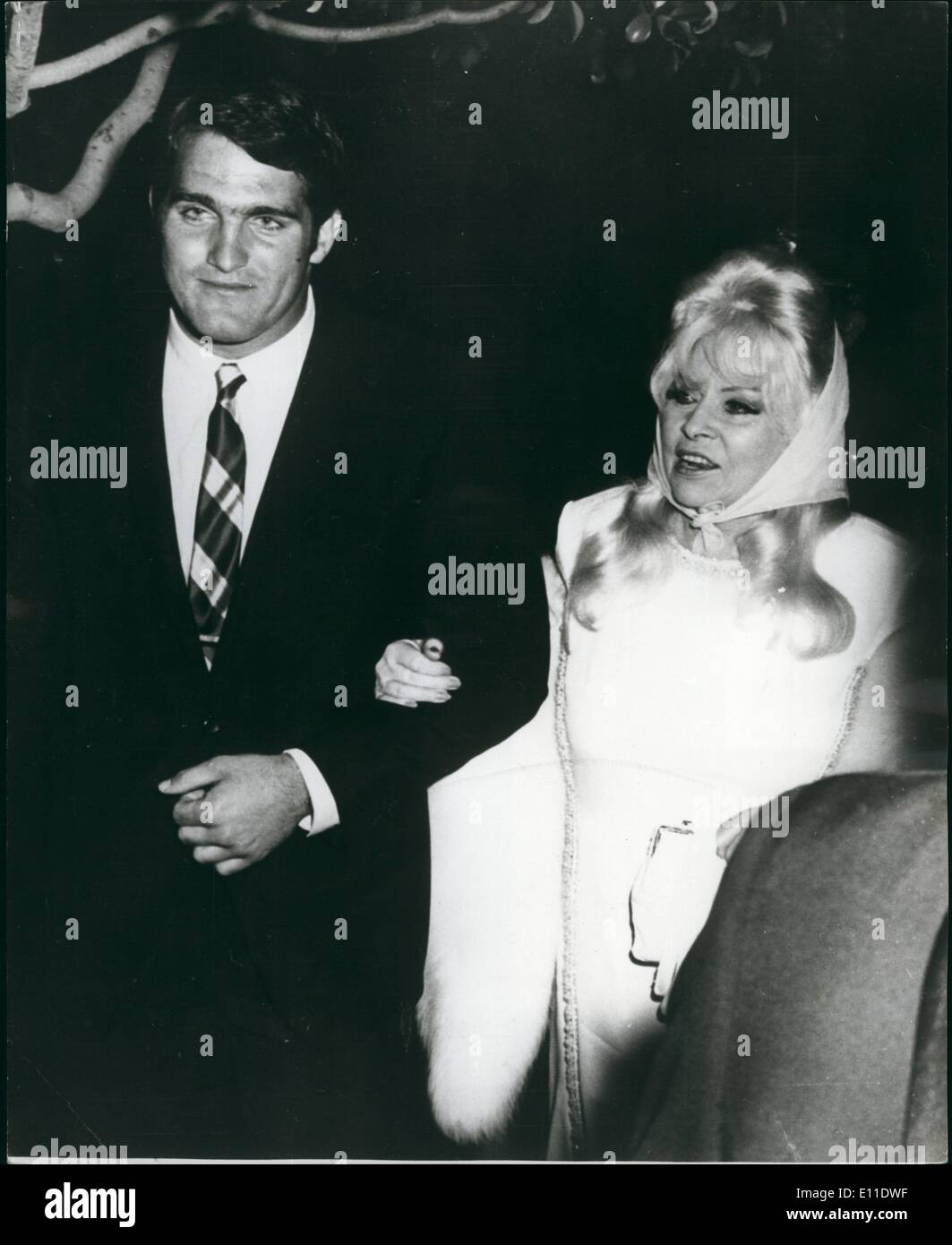 Sep. 09, 1977 - Mae West - Still Makes The Hollywood Scene: Mae West, whose hourglass figure made her the sexpot of films in the 1930's still makes the Hollywood scene despite her 76 years. Here she is seen with former professional football player, Adrian Strange. Mae seems to continue her leaning, towards young muscular men as she did in her ''Diamond Lil' days. - Stock Image